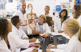 Students In Biology Class With Teacher